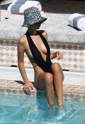 Actress and model Emily Ratajkowski wears a revealing black swimsuit while tanning in Miami. 15 Oct 2019 Pictured: Emily Ratajkowski. Photo credit: MEGA TheMegaAgency.com +1 888 505 6342 (Mega Agency TagID: MEGA527835_006.jpg) [Photo via Mega Agency]