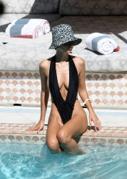 Actress and model Emily Ratajkowski wears a revealing black swimsuit while tanning in Miami. 15 Oct 2019 Pictured: Emily Ratajkowski. Photo credit: MEGA TheMegaAgency.com +1 888 505 6342 (Mega Agency TagID: MEGA527835_008.jpg) [Photo via Mega Agency]