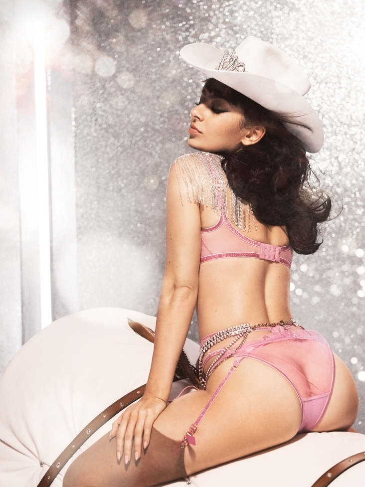 "Singer Charli XCX turns cowgirl as she stars in a rodeo-inspired campaign for lingerie brand Agent Provocateur. The 27-year-old features in the company's racy festive campaign ahead of Christmas. ""Nothing says Christmas like naughty and nice with a dash of cowgirl,"" said the star, real name Charlotte Emma Aitchison. ""I love all these pieces so much and this whole shoot day was so wild – so fun. It was a pleasure to work with such a legendary brand."" Editorial use only. Please credit AgentProvocateur.com/MEGA. 11 Nov 2019 Pictured: Charli XCX for Agent Provocateur. Photo credit: AgentProvocateur.com/MEGA TheMegaAgency.com +1 888 505 6342 (Mega Agency TagID: MEGA546719_005.jpg) [Photo via Mega Agency]"